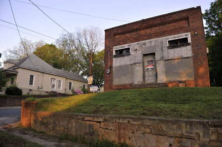 Harrill Street building was once a dance hall. Owner (lived in house, left) played piccolo for guests. Photo: Nancy Pierce