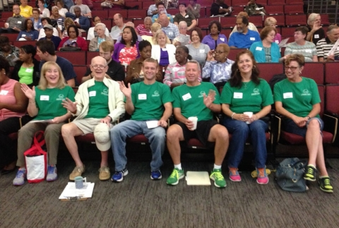 Neighbors from Coventry Woods in east Charlotte wore matching green T-shirts. Photo: Mary Newsom