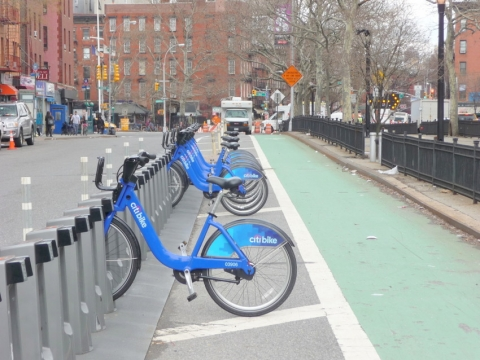 Bike share rack buffers bike lane, right, from traffic lane, left, in Manhattan. Photo: Martin Zimmerman