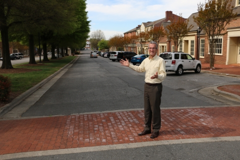Kannapolis Planning Director Zac Gordon stands in West Avenue, the main street in downtown Kannapolis. Photo: Mary Newsom