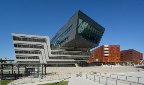 Award-winning architect Zaha Hadid's Library and Learning Center, left, at Vienna University of Economics and Business in Vienna, Austria. Photo: Peter Haas / CC-BY-SA-3.0 via Wikimedia Commons