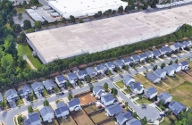 Google Earth image shows Henderson Oaks Drive is next to a large industrial-use site.