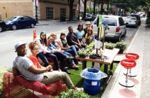 Group seated at parklet on North Tryon St. in 2014