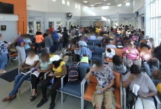 Crowded waiting room at Crisis Assistance Ministry in Charlotte one August morning. Photo: Nancy Pierce