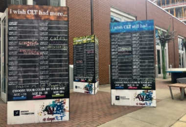 Blackboard totems with colored chalk have appeared around Charlotte to get people's ideas.