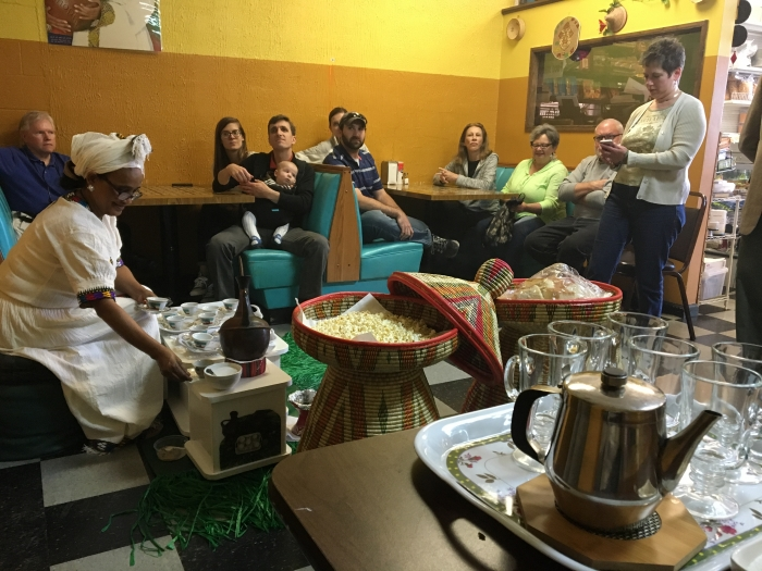 At the Nile Ethiopian Food and Spices grocery on North Sharon Amity Road in east Charlotte, co-owner Tsige Meshesha pours an Ethiopian coffee service for participants in a City Walk in May 2016 led by historian Tom Hanchett. Photo: Claire Apaliski