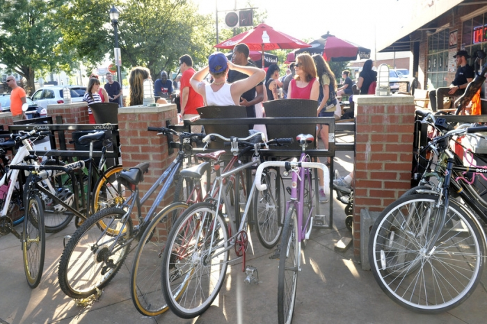 Bicycling's popularity is growing in Charlotte, as this scene at Plaza Midwood's Common Market attests. Photo: Nancy Pierce