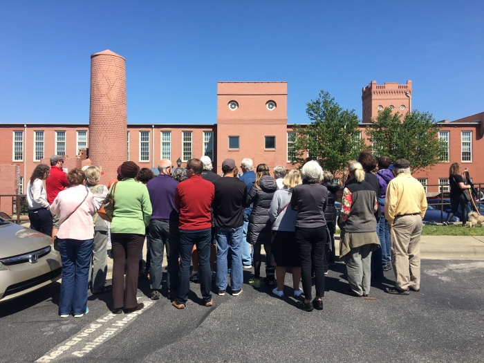 A crowd views the historic Highland Mill in the NoDa neighborhood. Photo: Mary Newsom