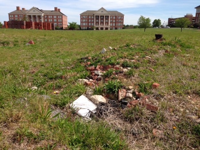 Rubble pile marks the remains of a now-demolished Cannon Mills textile plant that once dominated downtown Kannapolis. In the background are buildings of the N.C. Research Campus, which today occupies the mill site. Photo: Mary Newsom