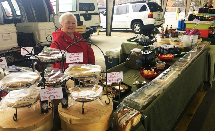 Suzanne Crawford sits at her food stand at the Charlotte Regional Farmers Market.