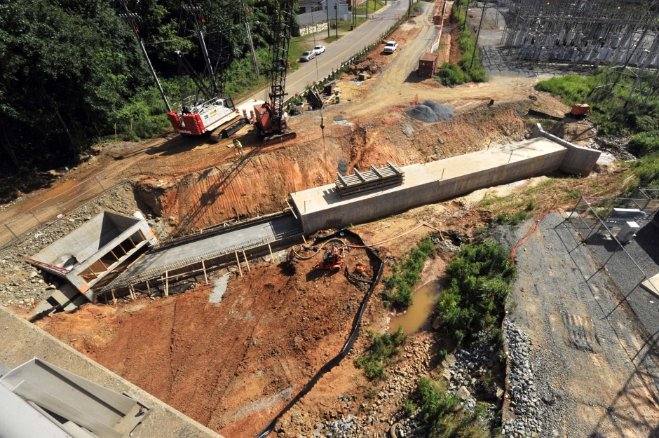 Brevard Street, viewed from Matheson. Blue Line Extension workers install a box culvert to protect workers from cave-ins. Photo: Nancy Pierce 6-11-15