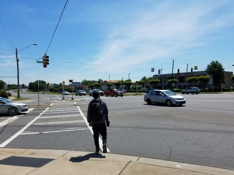 A pedestrian at John Kirk Drive and University City Drive, or NC 49, near UNC Charlotte.