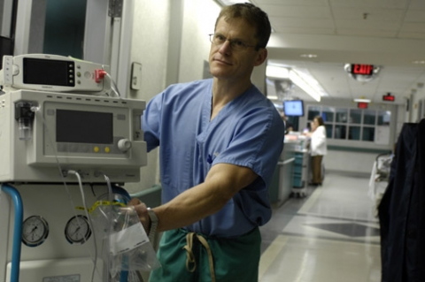 Dr. Jeffrey Kline, MD, director of research for the Department of Emergency Medicine at Carolinas Medical Center, wheels a device used for breath-based management of pulmonary embolism in the emergency department at CMC.