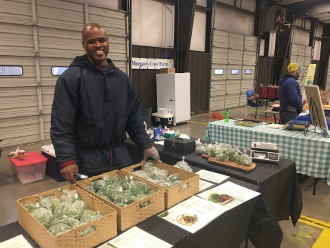 Gordon Mullings sells microgreens at Charlotte Regional Farmers Market.
