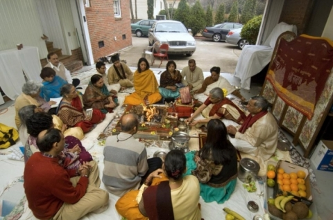 In a Charlotte carport, an Indian family holds a traditional Hindu Fire Ceremony. Photo: Nancy Pierce