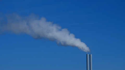 Smokestack emitting gas