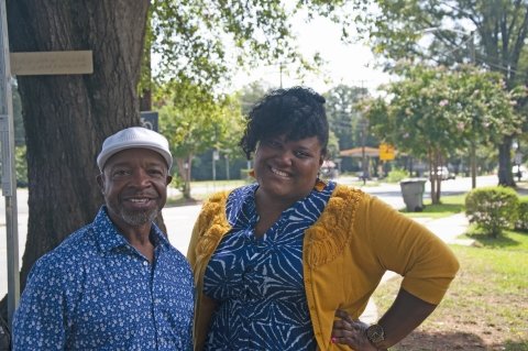 Rickey Hall,  a lifelong west Charlotte resident who co-founded the West Charlotte Community Land Trust, and executive director Charis Blackmon in front of the first lot the group purchased, on Tuckaseegee Road.