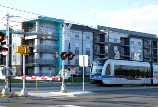 Light rail and TOD development make their mark in University City. From this intersection to Uptown by rail takes about 20 minutes. Photo by Nancy Pierce.