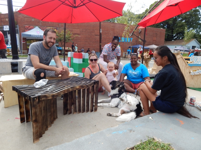 A group of people sits at pop-up furniture at the September Better Block event in Belmont. Photo: Lela Ijames