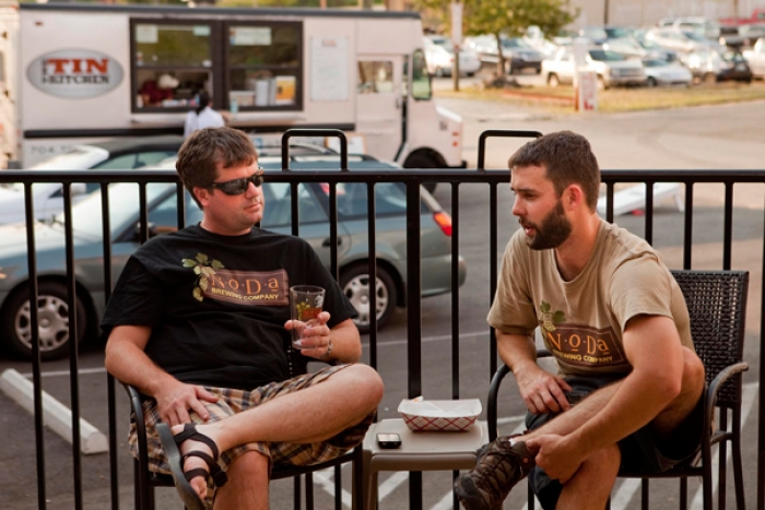 Assistant brewer Bart Roberts (right) and Ford Craven, enjoying a beer at NoDa Brewing Co. Photo: NoDa Brewing